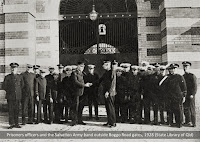 Prison officers greet the Salvation Army Band outside the gates of Boggo Road Gaol, Brisbane, 1928