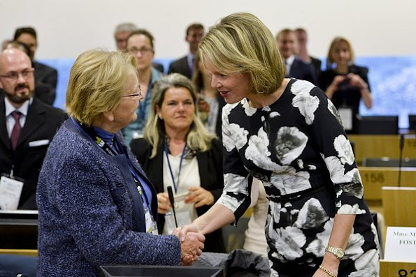 Queen Mathilde of Belgium looks on during her visit at the seminar 'European Union support to microfinance and social entrepreneurship: investing in job creation' and the inauguration of the First European Microfinance Day