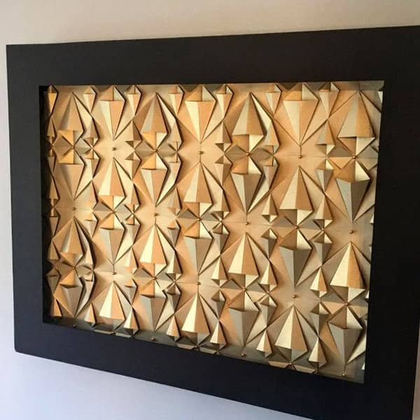 dimensional golden 3D paper sculpture in rectangular frame