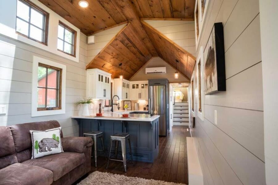02-Kitchen-and-Stairs-to-Bedroom-Timbercraft-Architecture-in-Mobile-Tiny-House-www-designstack-co