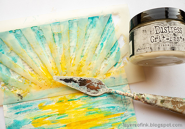 Layers of ink - Sunny Ocean and Beach Mixed Media Scene Tutorial by Anna-Karin Evaldsson. Apply translucent grit-paste through the Rays stencil.