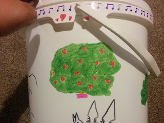 A Rose Bush, musical notes border and love hearts Sharpie Drawing on a Guides Camp Bucket