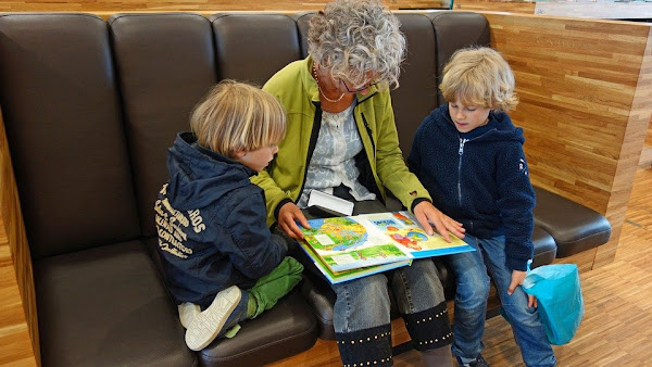 Image: Grandmother reading a book to her grandchildren, by Aline Dassel on Pixabay