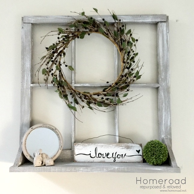Making a window shelf with an old chippy window and a wreath.