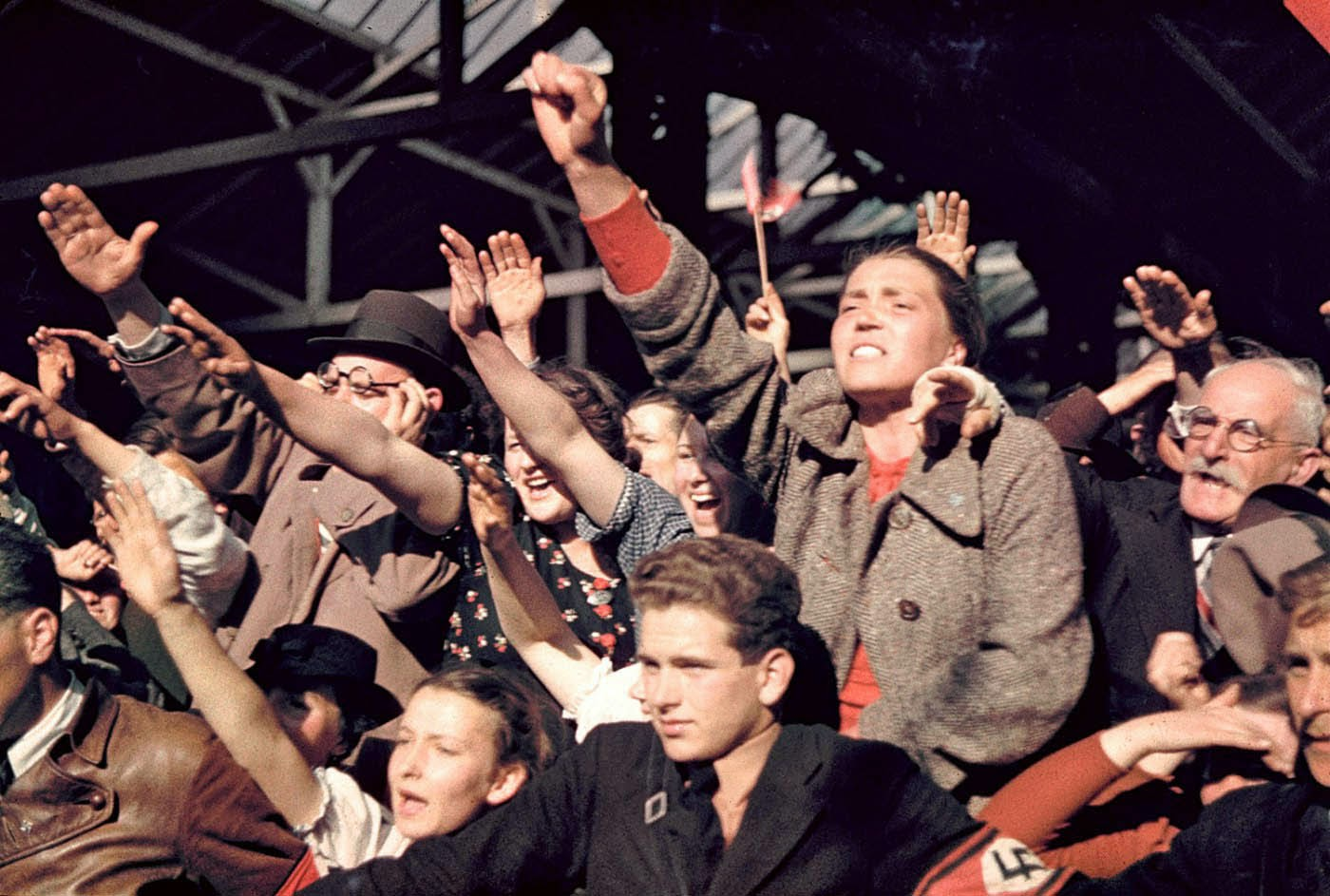 Crowds cheering Adolf Hitler's campaign to unite Austria and Germany, 1938.