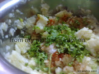 meshed potato  with coriander leaves, green chili,