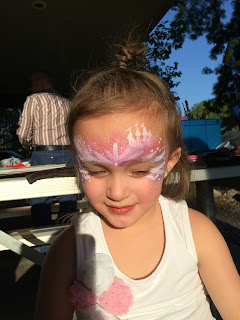 A Little Girl With A Princess Castle Painted on her face