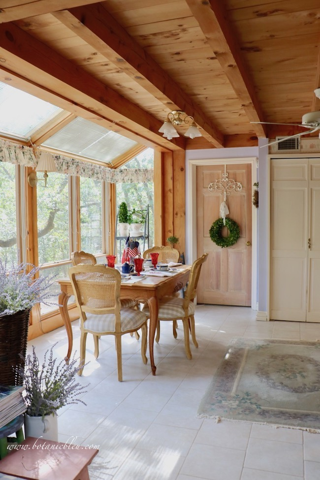 Labor Day patriotic French Country table setting in a post and beam sunspace
