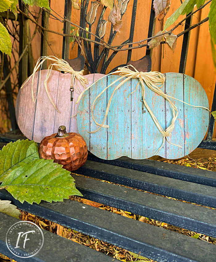 These rustic barn wood pumpkins look like the real thing but they are faux wood. Made with recycled dollar store pumpkin signs and decoupage paper.