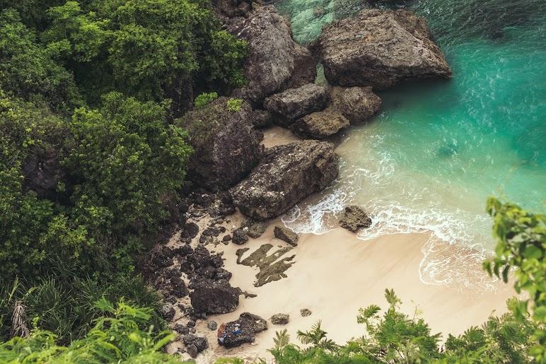 4k Wallpaper Background Beautiful Aerial View of Seashore Near Large Grey Rocks