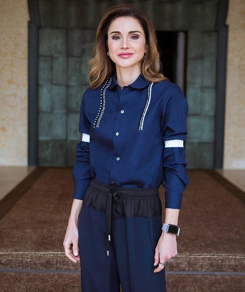 Queen Rania wore Cédric Charlier Shell trimmed Wool-blend wide leg pants, and wore Fendi Rockoko Slip On Booties and carried Fendi Peekaboo bag
