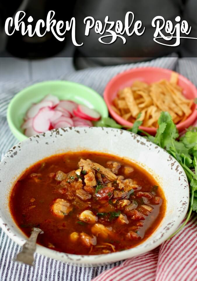 Pozole Rojo is a Mexican soup with an ancho chile broth that is filled with hominy. It is a delicious celebration soup that is meant to be garnished with all kinds of add-ins.