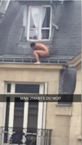 A Naked man spotted hiding by a window