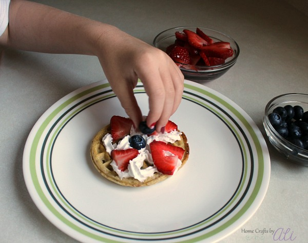 Tween decorating waffle with toppings