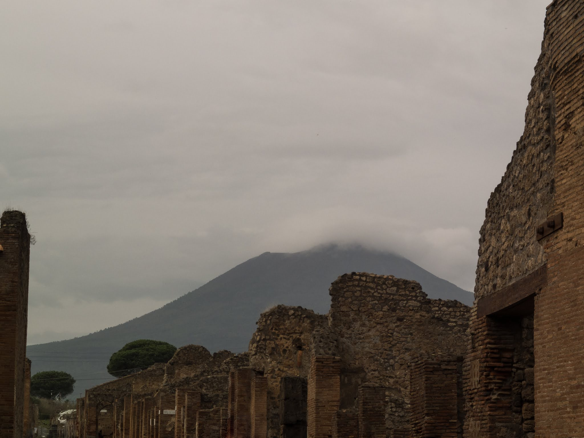 View of Mount Vesuvius from the streets of ancient Pompeii.