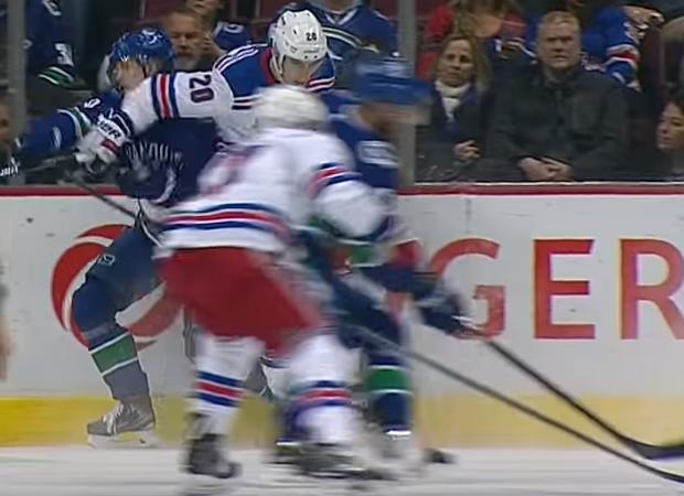 Chris Kreider elbows Elias Pettersson in face