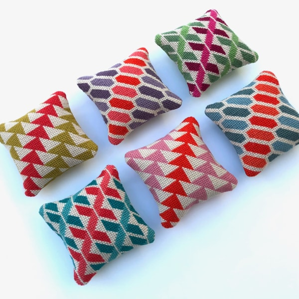 6 mini needlepoint cushions with geometric designs