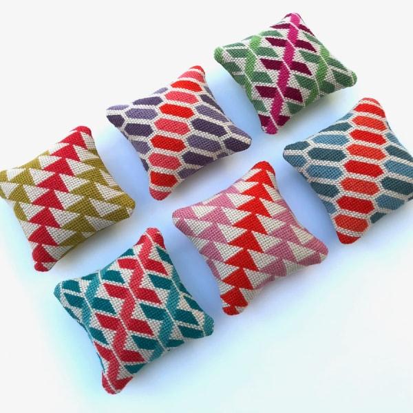 6 mini needlepoint cushions with geometric designs