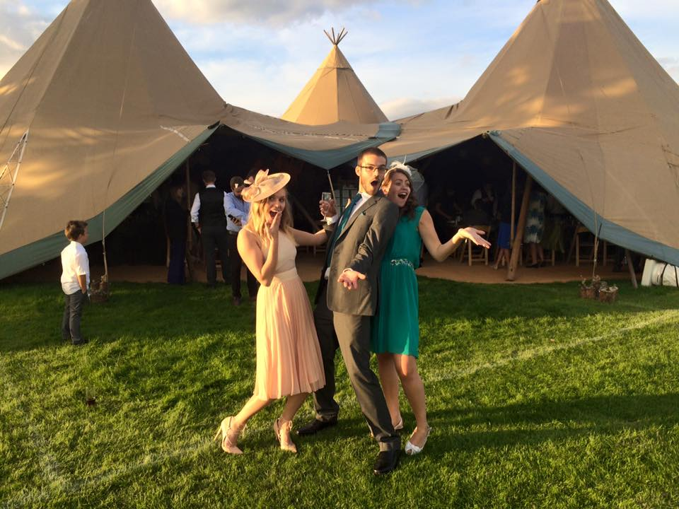 Rachel Emily laughing with friends outside the wedding tent wearing ASOS