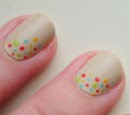 http://onceuponnails.blogspot.com/2013/10/dots-and-feathers.html