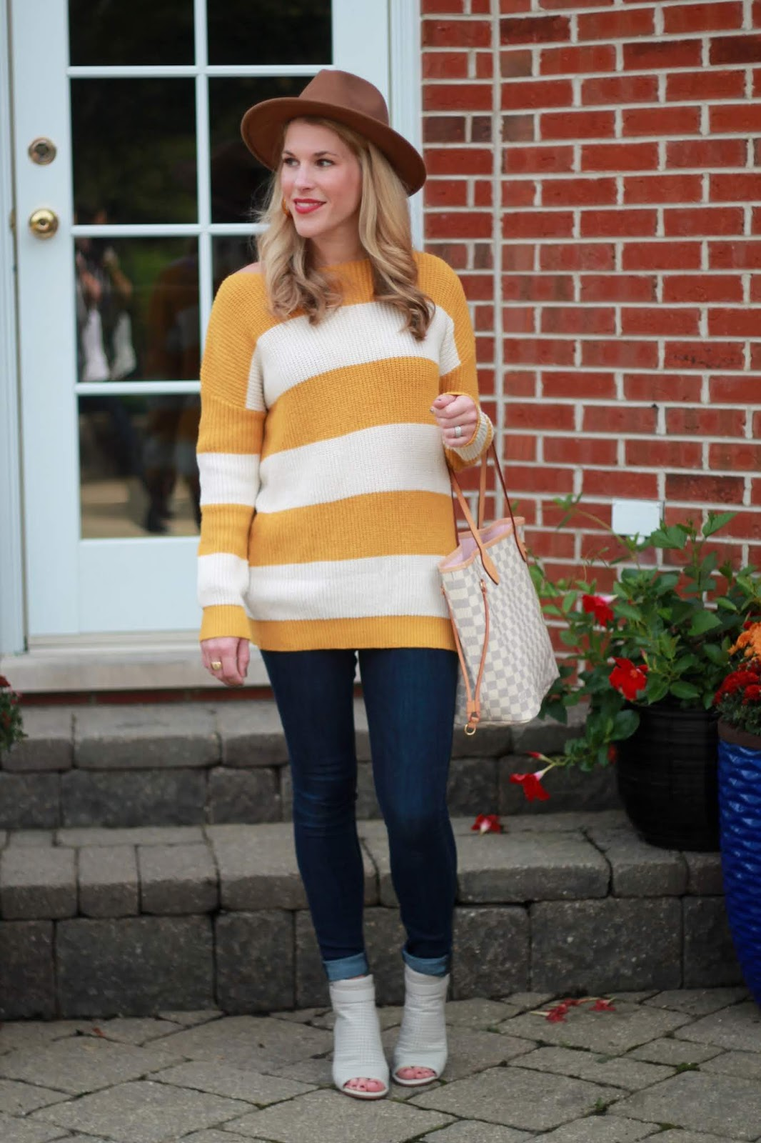 mustard yellow striped sweater, camel  fedora, dark rinse skinny jeans, grey peep toe booties, LV azure neverfull