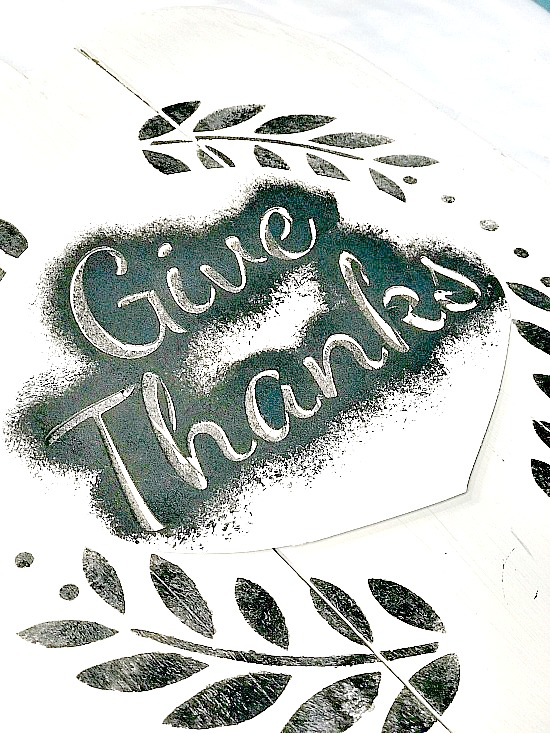 White pumpkin pallet with give thanks stencil