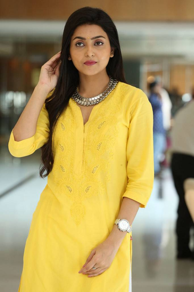 Indian Film Actress Avantika Mishra Long Hair Stills In Yellow Dress
