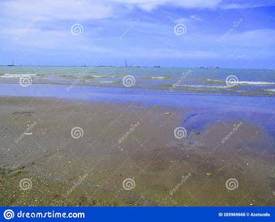 ujunggebang-beach-near-plentong-looking-far-off-to-middle-aka-blue-sea-visitors-having-fun-enjoying-atmosphere-205969668