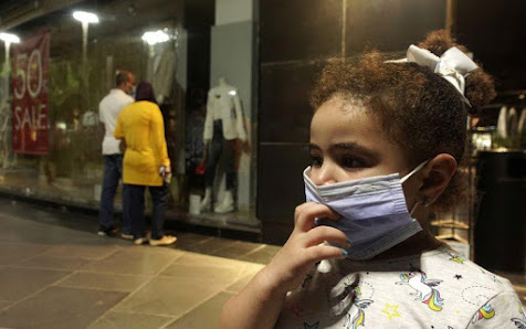 "A girl wearing a mask in Cairo in Downtown Cairo ""Reuters"""