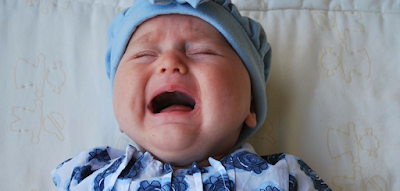 When a baby gets upset, we say it is being _____. (image)