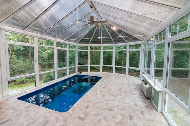 A Performance Endless Pools swimming machine in a conservatory addition