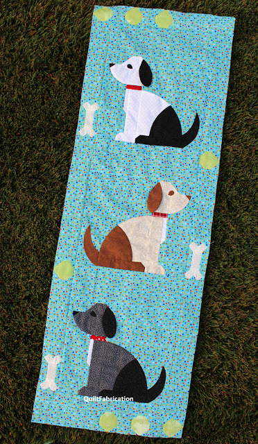 dog quilt blocks along with bones and tennis balls