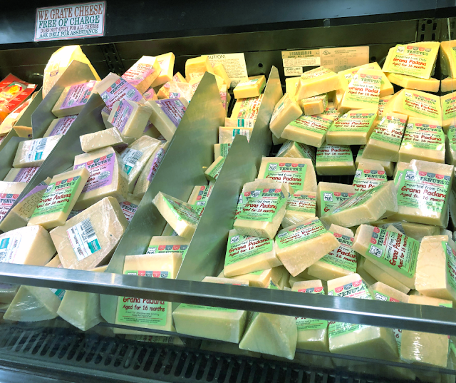 Choosing from mounds of Italian cheese at Tenuta's in Kenosha, Wisconsin