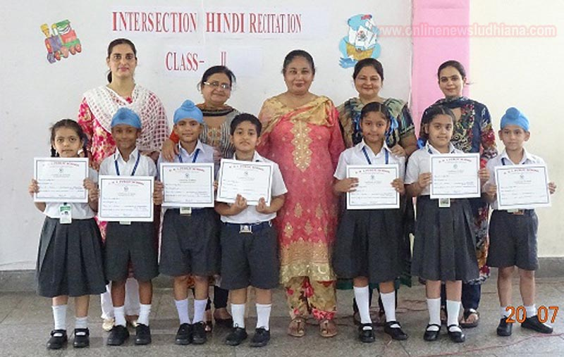 Winners of intersection Hindi Poem Recitation with teachers at Guru Nanak International Public School