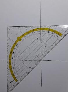 Hier zie je hoe de driehoek precies op het kruispunt van zoom en splitbeleg wordt gelegd.