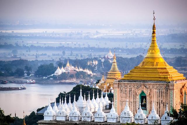 """Bởi vì qua ảnh, Mandalay quá đẹp với một màu trắng xóa và vàng đồng lấp lánh phủ kín cả không gian và quả thực Mandalay chính là thành phố của những ngôi đền, những hình ảnh quá đẹp về một thành phố của Phật giáo, những cảm nhận cá nhân từ góc nhìn của một kẻ """"vô thần"""" khi được chiêm ngưỡng những gì linh thiêng và đáng chiêm ngưỡng nhất của những công trình kiến trúc nhuốm màu tôn giáo."""