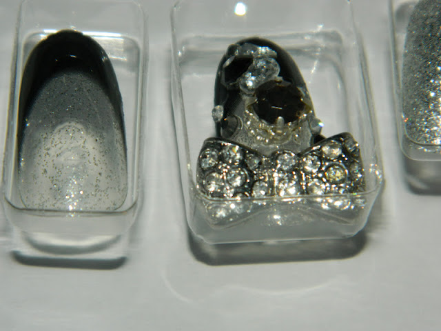 close up of glitzy black and clear bling false nails