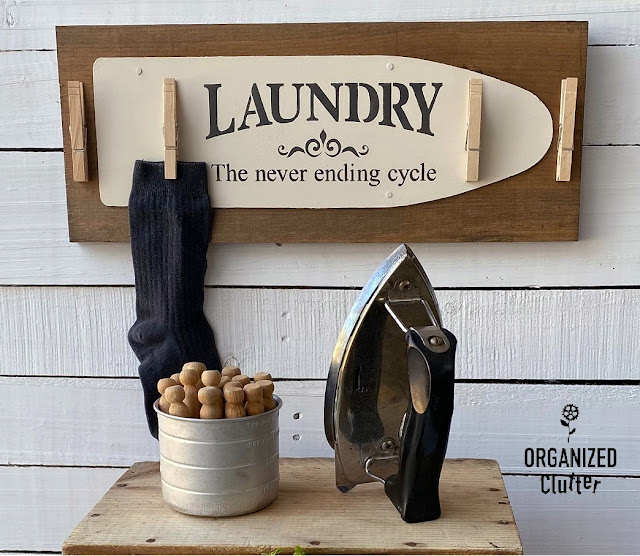 Photo of laundry room sign with clothespins