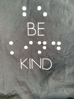 my new tshirt, Black background with words BE KIND also written in Braille and print