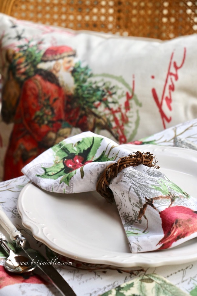 Cardinal Christmas Table Setting with grapevine wreath napkin rings and a Santa pillow