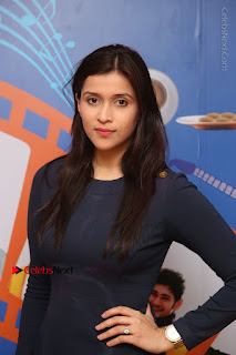 Actress Mannara Chopra Stills in Blue Short Dress at Rogue Song Launch at Radio City 91.1 FM  0031.jpg