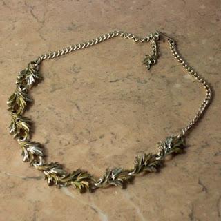 Golden enamel leaf necklace by Exquisite