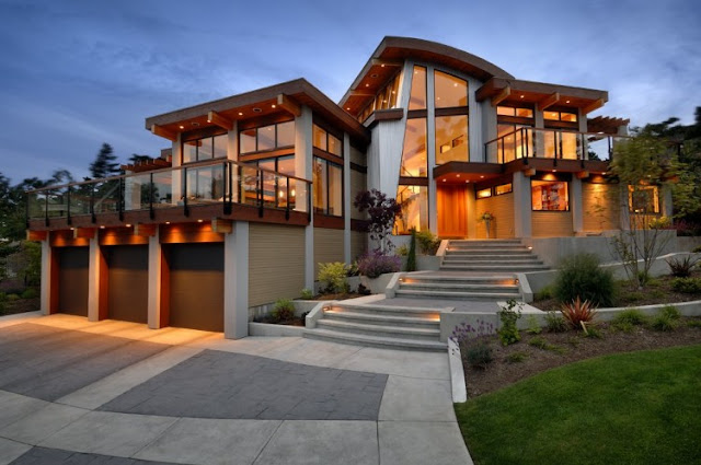Photo of an amazing home at sunset as seen from the driveway