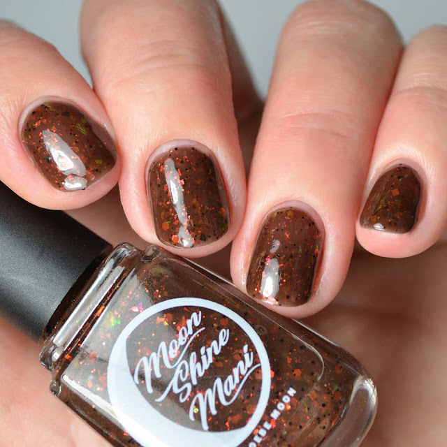 brown nail polish with flakies swatch