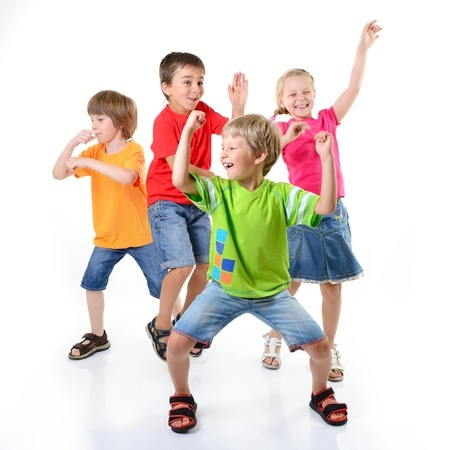 Kids dancing and playing around. This is a book review of Move to Learn by Grade ONEderful.