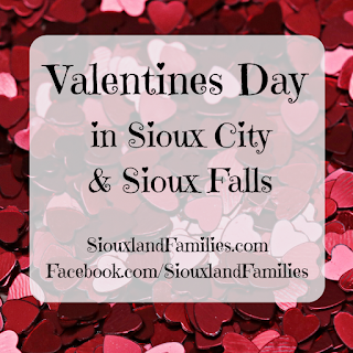 "in background, a pile of tiny red confetti hearts. in foreground, the words ""Valentines Day in Sioux City & Sioux Falls"" and ""SiouxlandFamilies.com"""