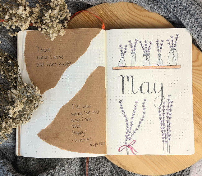 Double page journal spread with a poem on the left hand side and the word 'May' on the right hand side surrounded by bouquets of lavender flowers