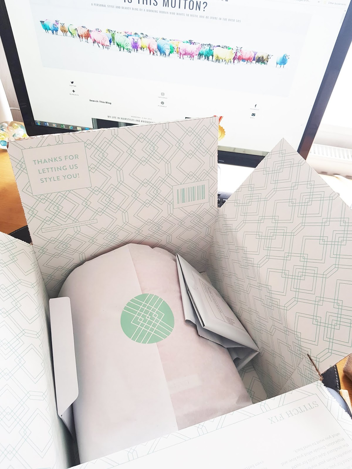 Stitch Fix delivery box with tissue wrapped garments
