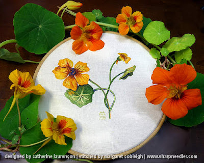 Finished thread painted nasturtiums surrounded by real nasturtiums. (Catherine Laurencon Capucines (Inspirations))