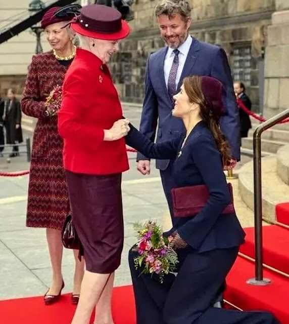 Crown Princess Mary wore a crepe knit wrap jacket by Scanlan Theodore. Queen Margrethe, Princess Benedikte, Prince Frederik
